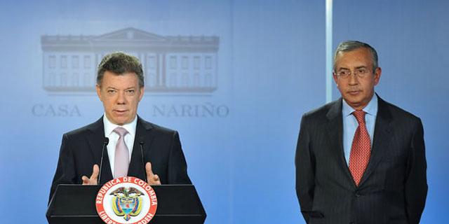 Juan Manuel Santos y el ministro de Agricultura Francisco Estupiñán