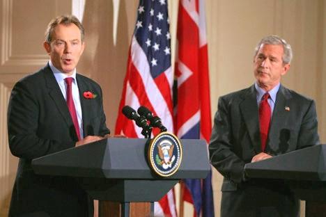 Tony Blair y George Bush.